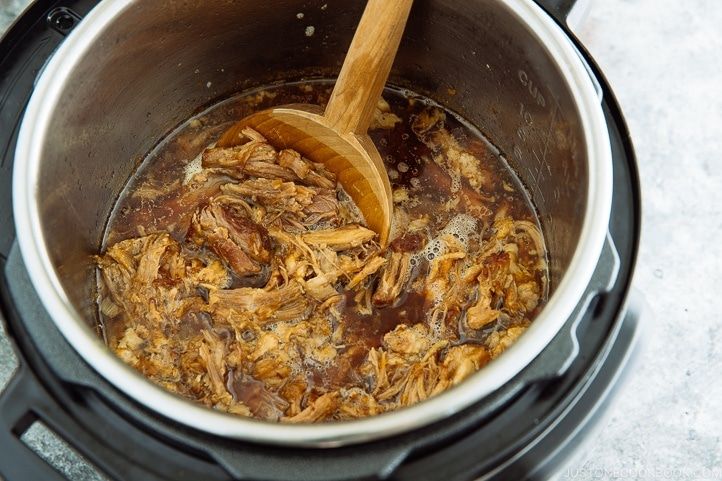 Flavorful and fall-apart tender Asian Pulled Pork in the Instant Pot.