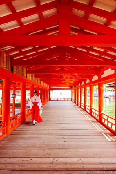 priestess walking Itsukushima Shrine | JustOneCookbook.com