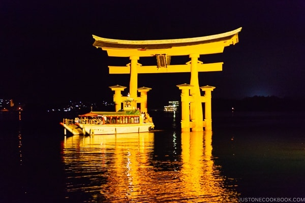 boat going through Torii gate Itsukushima | JustOneCookbook.com