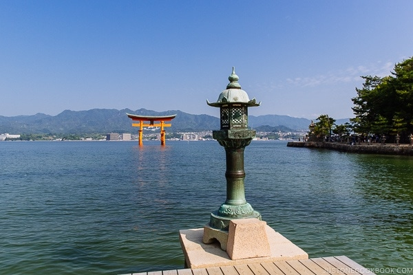 view of stone lantern and torii gate | JustOneCookbook.com