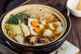 Monkfish hot pot in a black Japanese earthenware donabe.