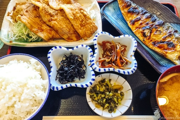 Japanese lunch meal set with ginger pork, grilled mackerel and korokke.