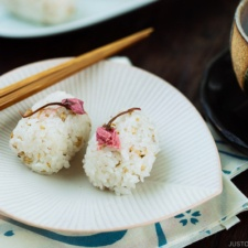 Cherry Blossom Rice Balls on a white ruffled plate.