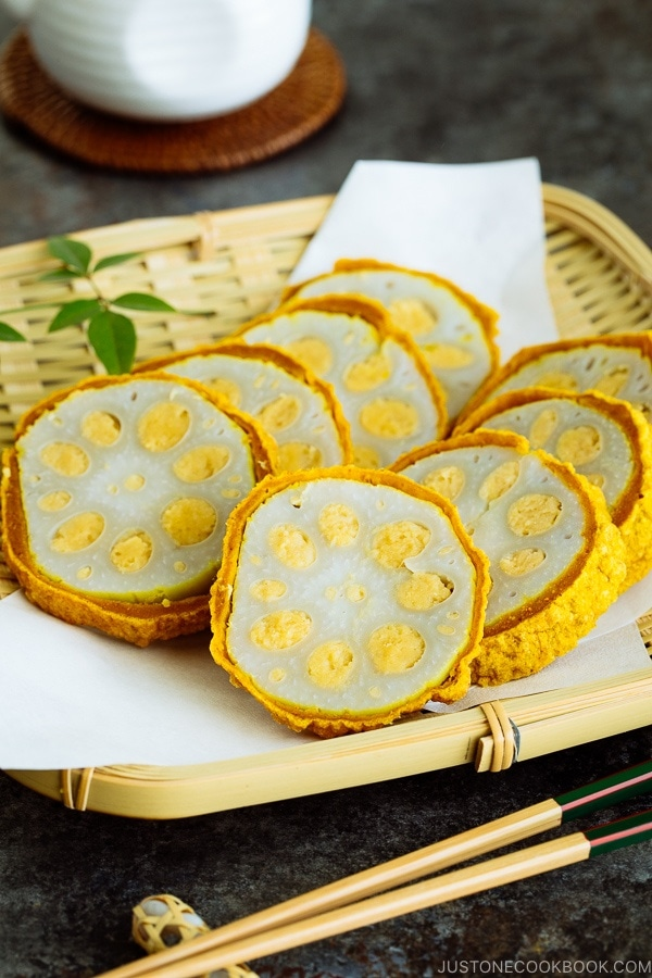 Karashi Renkon - deep fried lotus root stuffed with Japanese hot mustard miso on a bamboo basket.