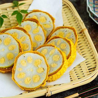 Karashi Renkon - deep fried lotus root stuffed with Japanese hot mustard miso on a bamboo basket.