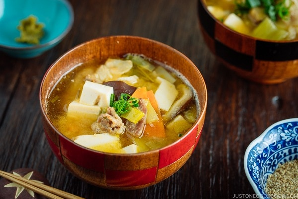 Pork belly and vegetable miso soup served in the Japanese wooden bowl.