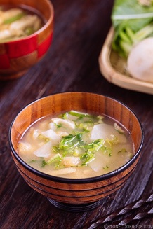 Japanese turnip miso soup in a wooden bowl.