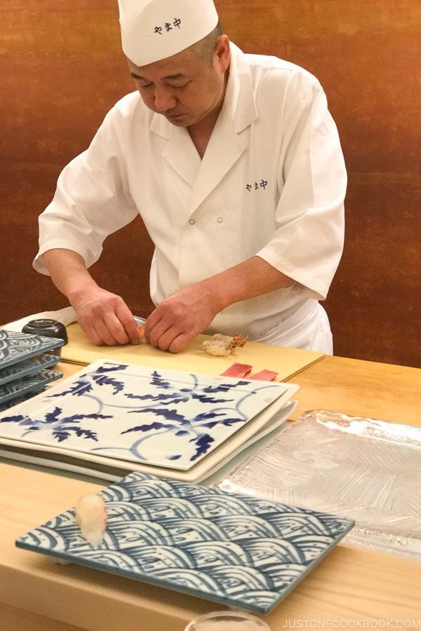 chef preparing sushi at Sushi Yamanaka - Fukuoka Travel Guide   justonecookbook.com