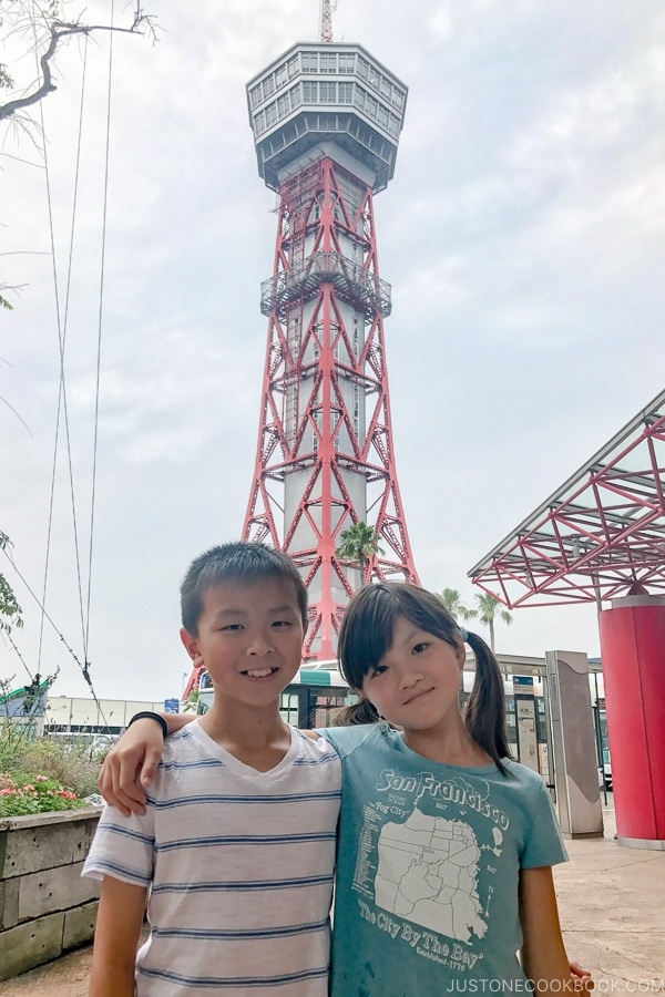 children in front of Hakata Port Tower - Fukuoka Travel Guide | justonecookbook.com