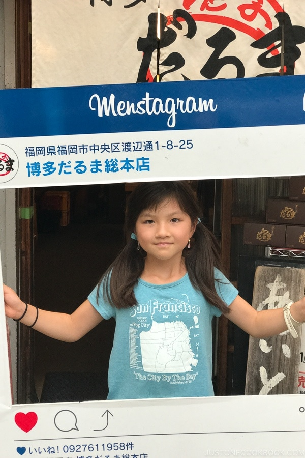 child with Instagram sign in front of Hakata Daruma - Fukuoka Travel Guide | justonecookbook.com