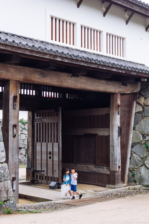 children standing inside Fukuoka Castle Gate - Fukuoka Travel Guide | justonecookbook.com