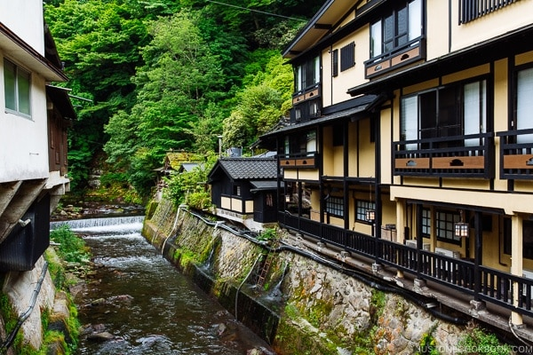 view of river and Shinmei-kan 山の宿 新明館 - Kurokawa Onsen Travel Guide | justonecookbook.com