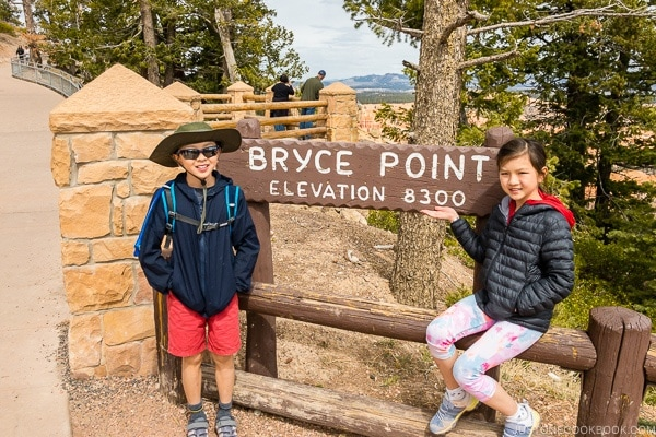 children next to Bryce Point sign - Bryce Canyon National Park Travel Guide | justonecookbook.com