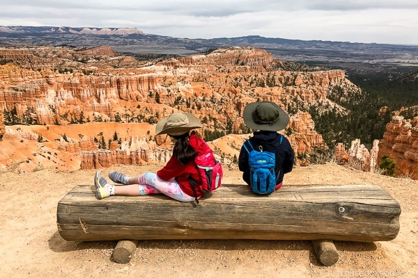children on a bench on the rim trail near Sunset Point - Bryce Canyon National Park Travel Guide | justonecookbook.com
