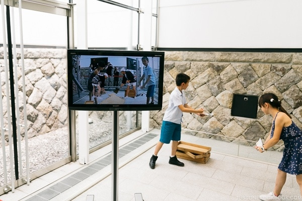 children acting in augmented reality scene at Imperial soy sauce brewery at Kikkoman Factory in Noda Japan | justonecookbook.com