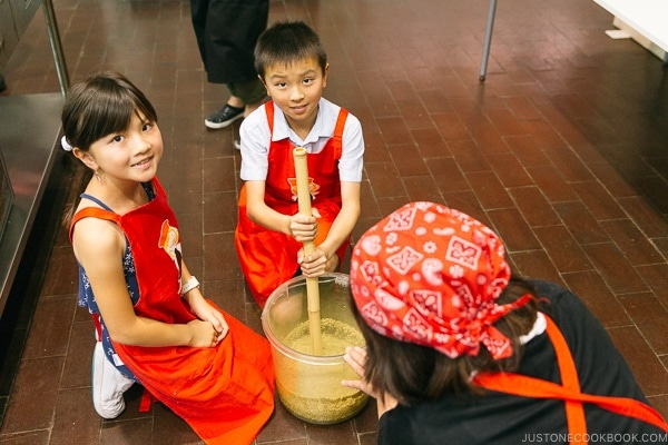 children mixing soy sauce mixture at at Kikkoman Factory in Noda Japan | justonecookbook.com