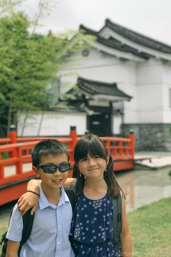 children in front of Imperial soy sauce brewery at Kikkoman Factory in Noda Japan | Kikkoman Factory Tour - justonecookbook.com