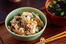 Rice with Mountain Vegetables (Sansai Gohan) served in a green ceramic bowl.