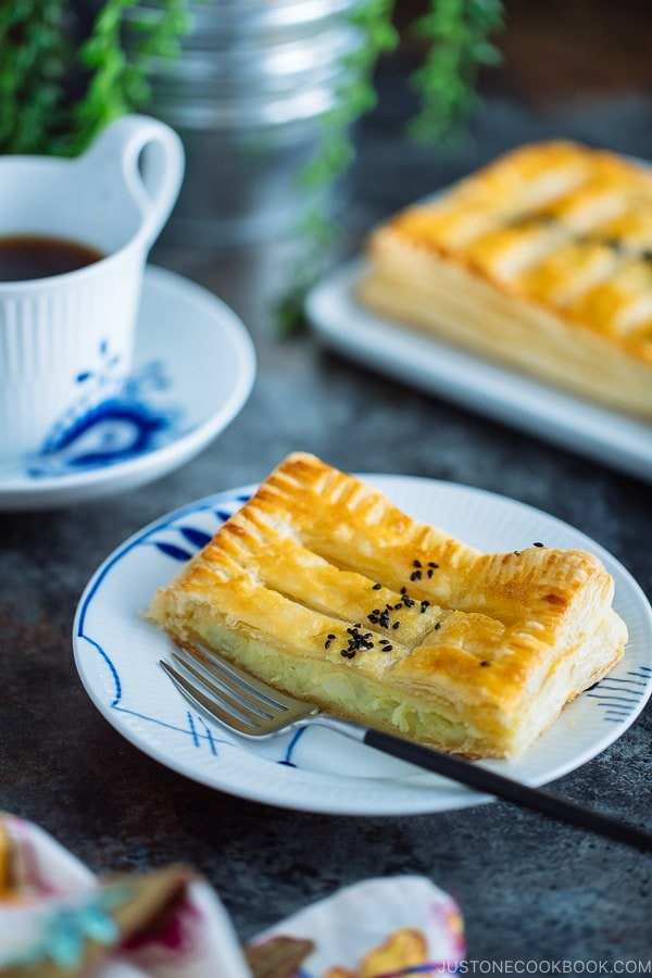 Japanese sweet potato pie/puff pastry is on a white plate.