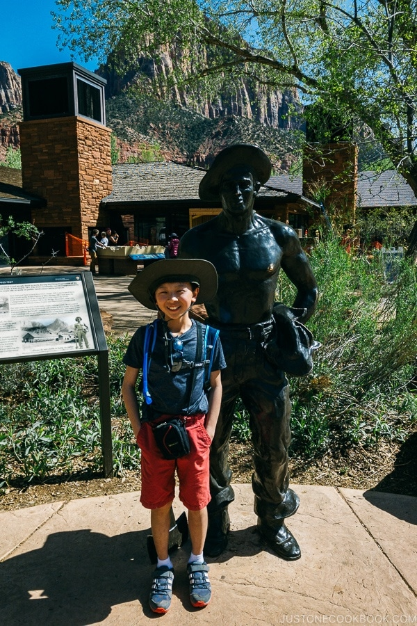 child in front of statue near Zion visitor center - Zion National Park Travel Guide | justonecookbook.com