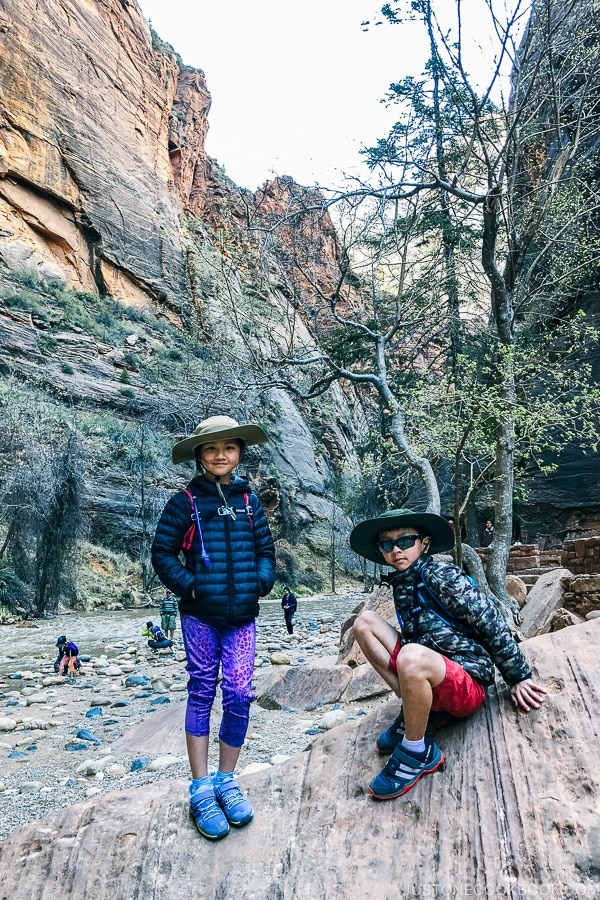 children on rock at the end of Riverside Walk - Zion National Park Travel Guide | justonecookbook.com