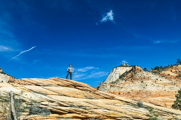 Nami standing on sandstone hills off Zion-Mount Carmel Highway - Zion National Park Travel Guide | justonecookbook.com