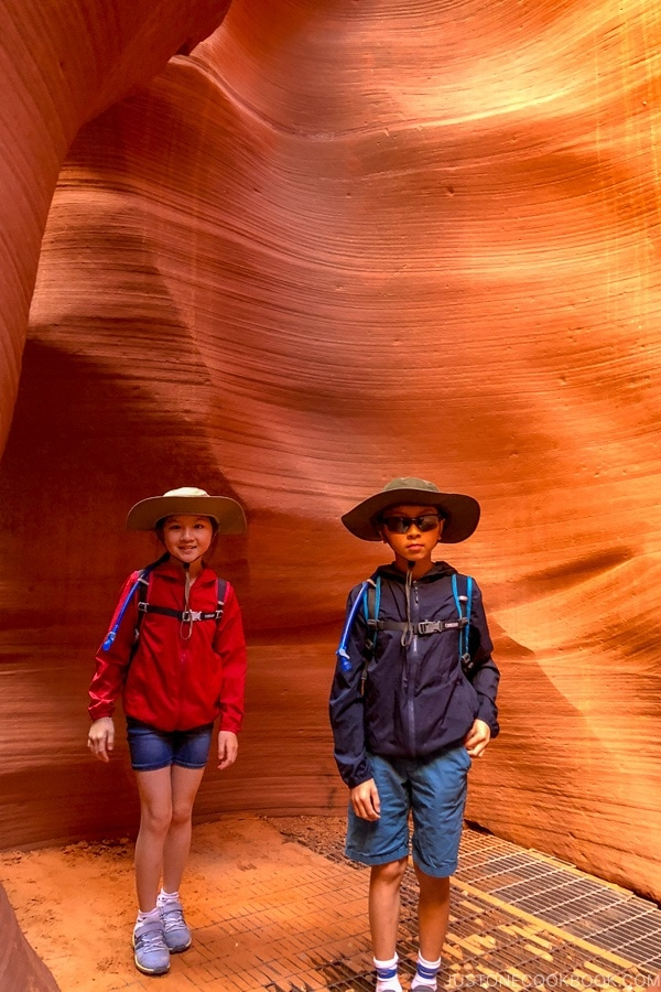 children standing in front of sand rock wall - Lower Antelope Canyon Photo Tour | justonecookbook.com