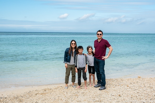 Just One Cookbook family next to clear ocean and sandy beach at Ocean Expo Park Okinawa | justonecookbook.com