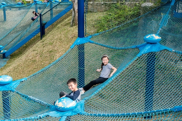 children playing at outdoor playground in front of Churaumi aquarium at Ocean Expo Park Okinawa | justonecookbook.com