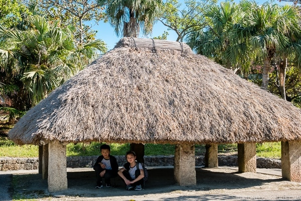 children under traditional Ryukyu grass hut at Ocean Expo Park Okinawa | justonecookbook.com