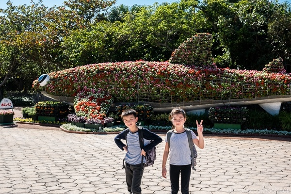 children in front of plants shaped like a whale shark at Ocean Expo Park Okinawa | justonecookbook.com
