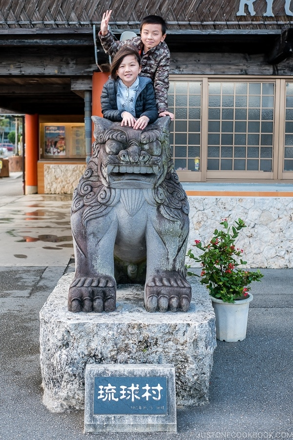 Just One Cookbook children on shisa statue at Ryukyu Mura Okinawa | justonecookbook.com
