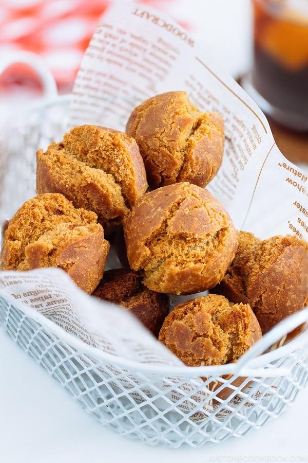 Sata Andagi (Okinawan Doughnuts) in a white basket.