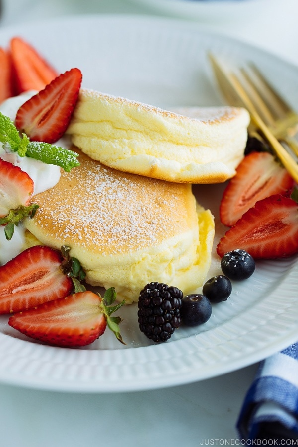 Japanese Souffle Pancakes with berries and fresh whipped cream.