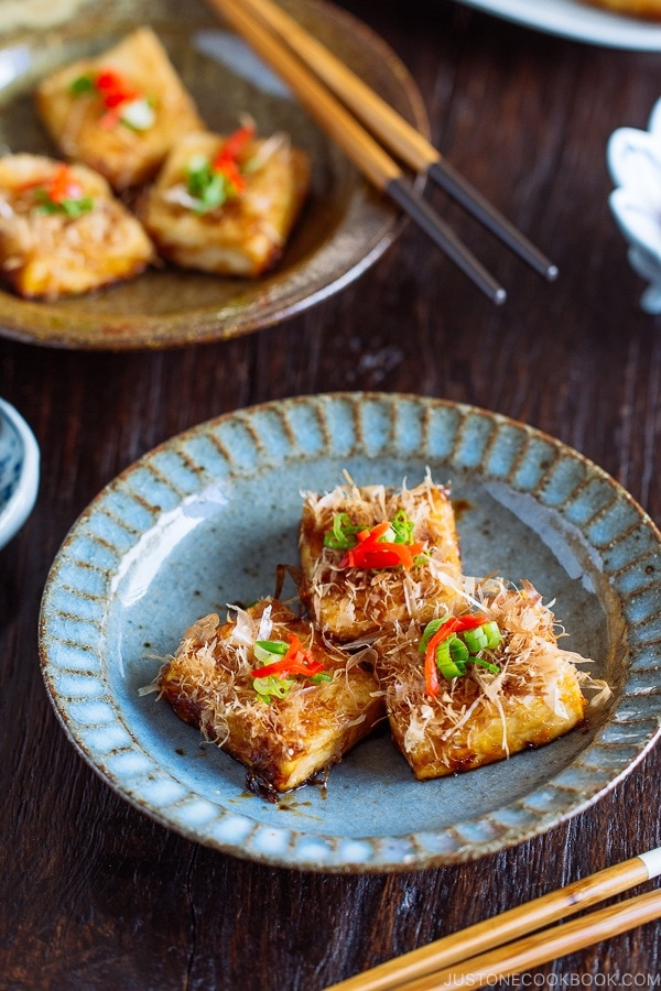 Three pieces of Teriyaki Tofu are placed on a Japanese blue plate | Easy. Japanese Recipes at JustOneCookbook.com