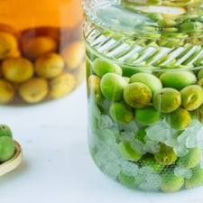 Japanese plum wine (umeshu) in a glass jar.