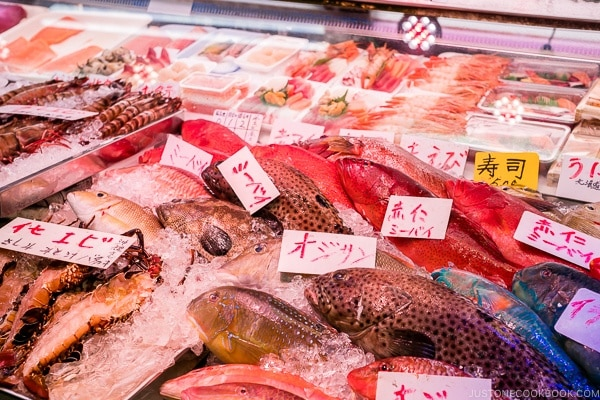 vendor selling seafood at First Makishi Public Market - Okinawa Travel Guide | justonecookbook.com