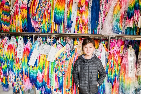 child in front of folded cranes at Himeyuri Peace Museum - Okinawa Travel Guide | justonecookbook.com