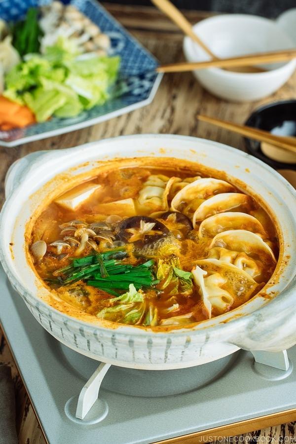 Kimchi Gyoza Nabe served in donabe (Japanese earthenware pot).