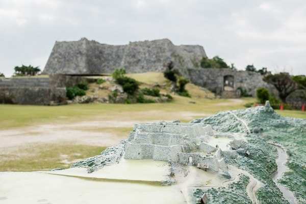 model of Nakagusuku Castle with the actual castle in the background - Okinawa Travel Guide | justonecookbook.com