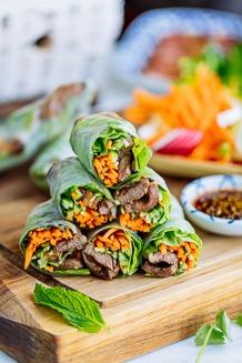 Fresh spring rolls with Yakiniku (Japanese BBQ) and julienned vegetables and fresh herbs along with homemade Yakiniku Sauce.