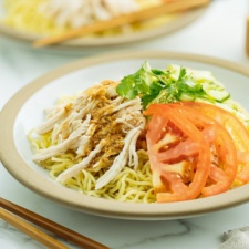 Cold Ramen - Hiyashi Chuka with Sesame Miso Sauce served with cucumbers, tomato, shredded blanched chicken.