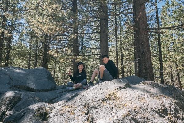 Just One Cookbook children on top of large boulder - Lassen Volcanic National Park Travel Guide | justonecookbook.com