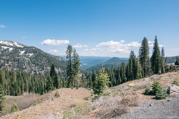 view of trees and nearby mountains - Lassen Volcanic National Park Travel Guide | justonecookbook.com