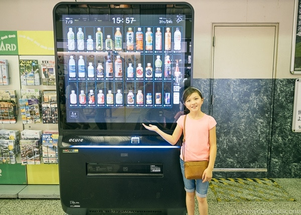 Just One Cookbook children in front of digital drink vending machine - Shinjuku Travel Guide | justonecookbook.com