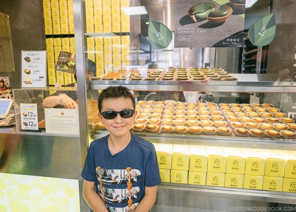 Just One Cookbook child in front of Bake Cheese Tart Lumine EST - Shinjuku Travel Guide | justonecookbook.com