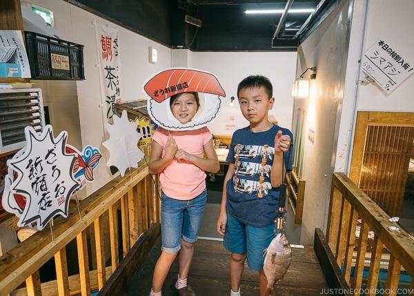 Just One Cookbook children with fish caught at Zauo Shinjuku ざうお新宿店 - Shinjuku Travel Guide | justonecookbook.com