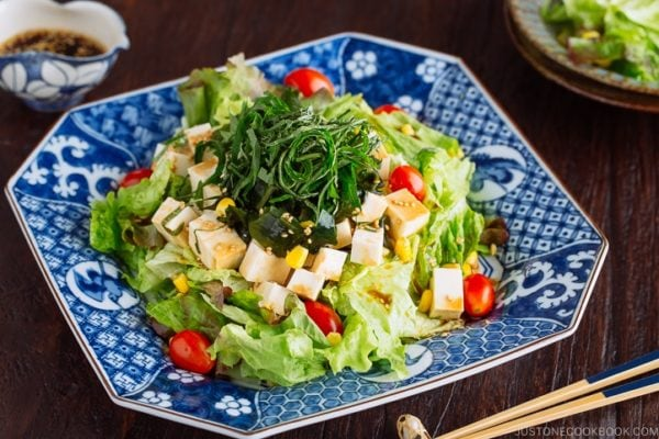 Refreshing Tofu Salad with Sesame Ponzu Dressing on a Japanese blue platter.