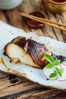 Beautifully charred Miso Cod (Black Cod with Miso) served on a white Japanese ceramic.
