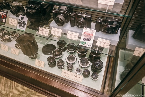 vintage camera and lenses on display at Fujifilm Square Tokyo Midtown - Tokyo Roppongi Travel Guide | www.justonecookbook.com